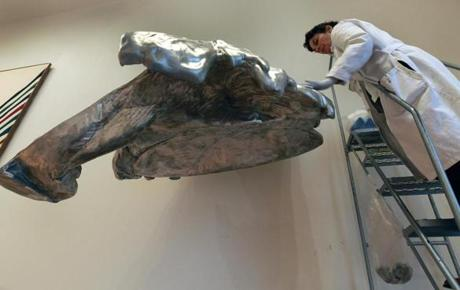 Pamela Hatchfield cleans ''Wing,'' an aluminum sculpture by Lynda Benglis in the Linde Family Wing for Contemporary Art at the Museum of Fine Arts.